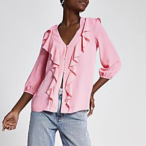 Roze blouse met ruches voor