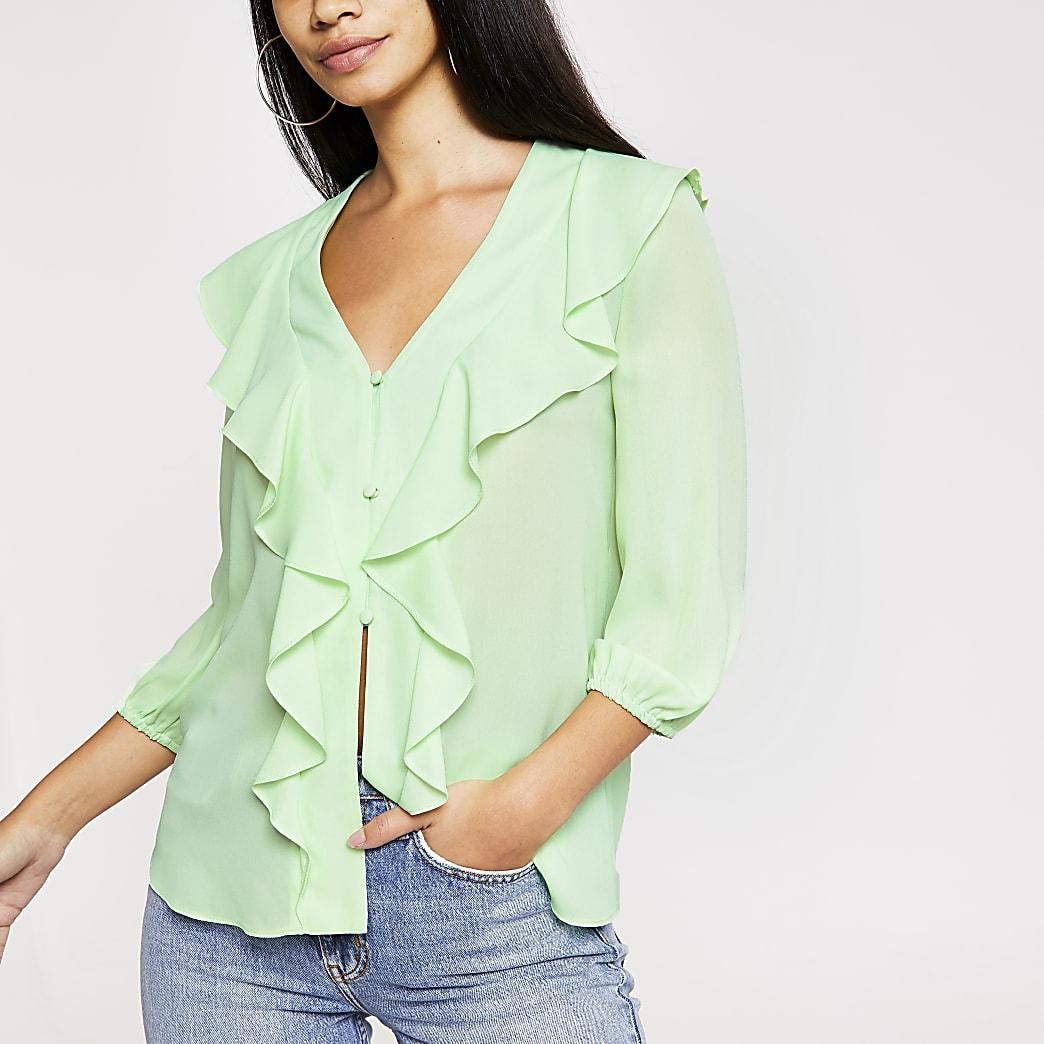Lichtgroene blouse met ruches voor