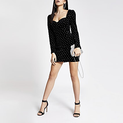 Black velvet studded long sleeve mini dress