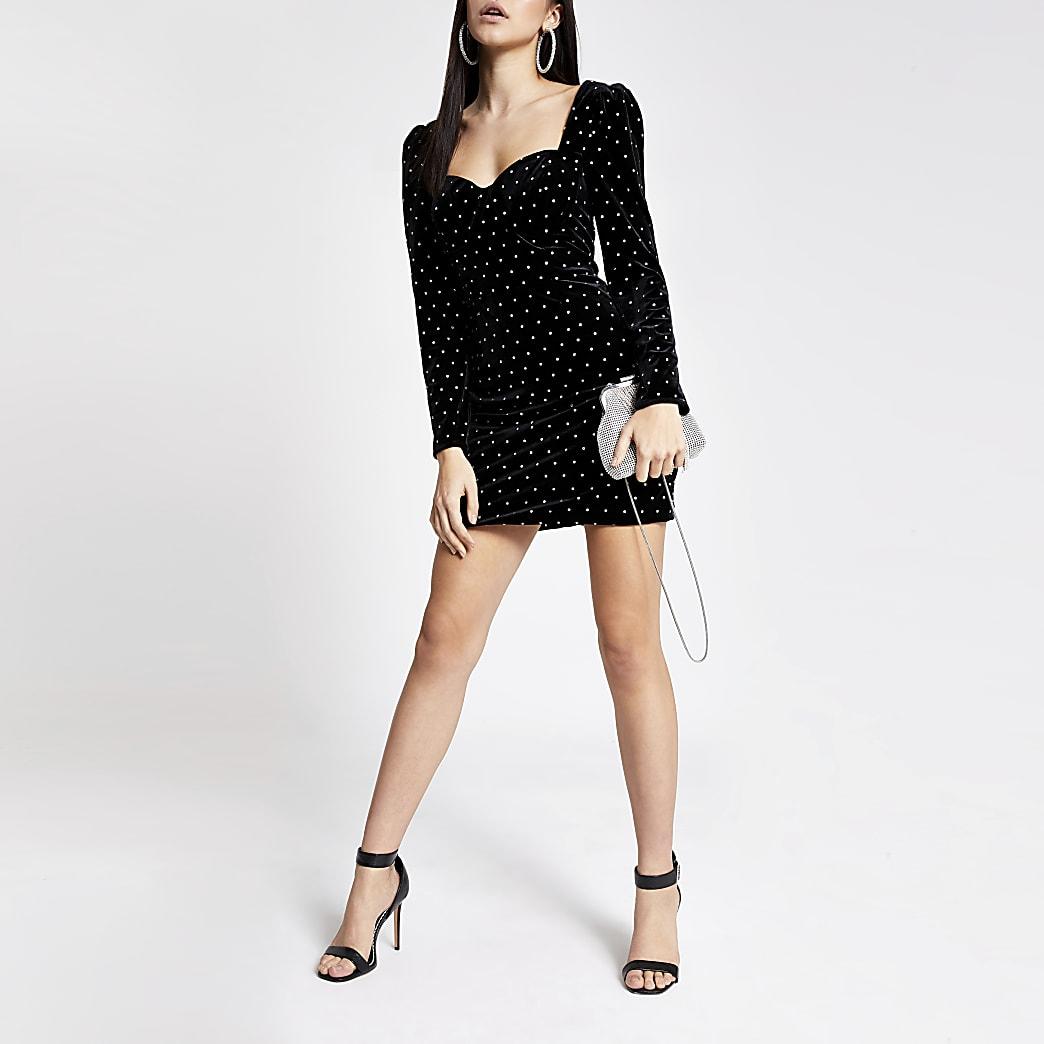 Black velvet studded long sleeve mini dress