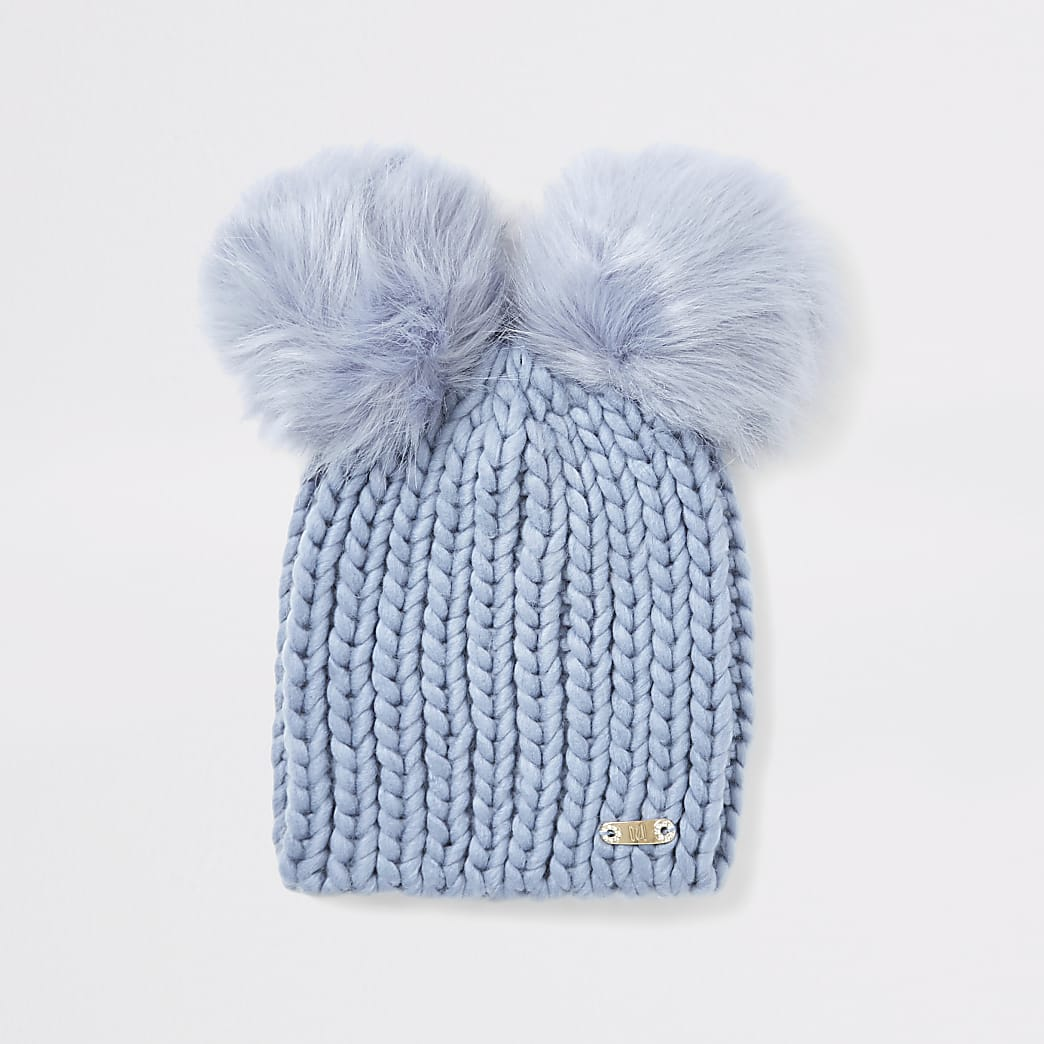 Blue faux fur pom pom beanie hat