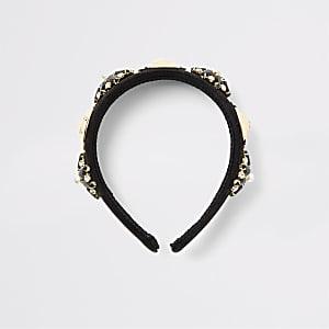 Schwarzes Stirnband mit Verzierung