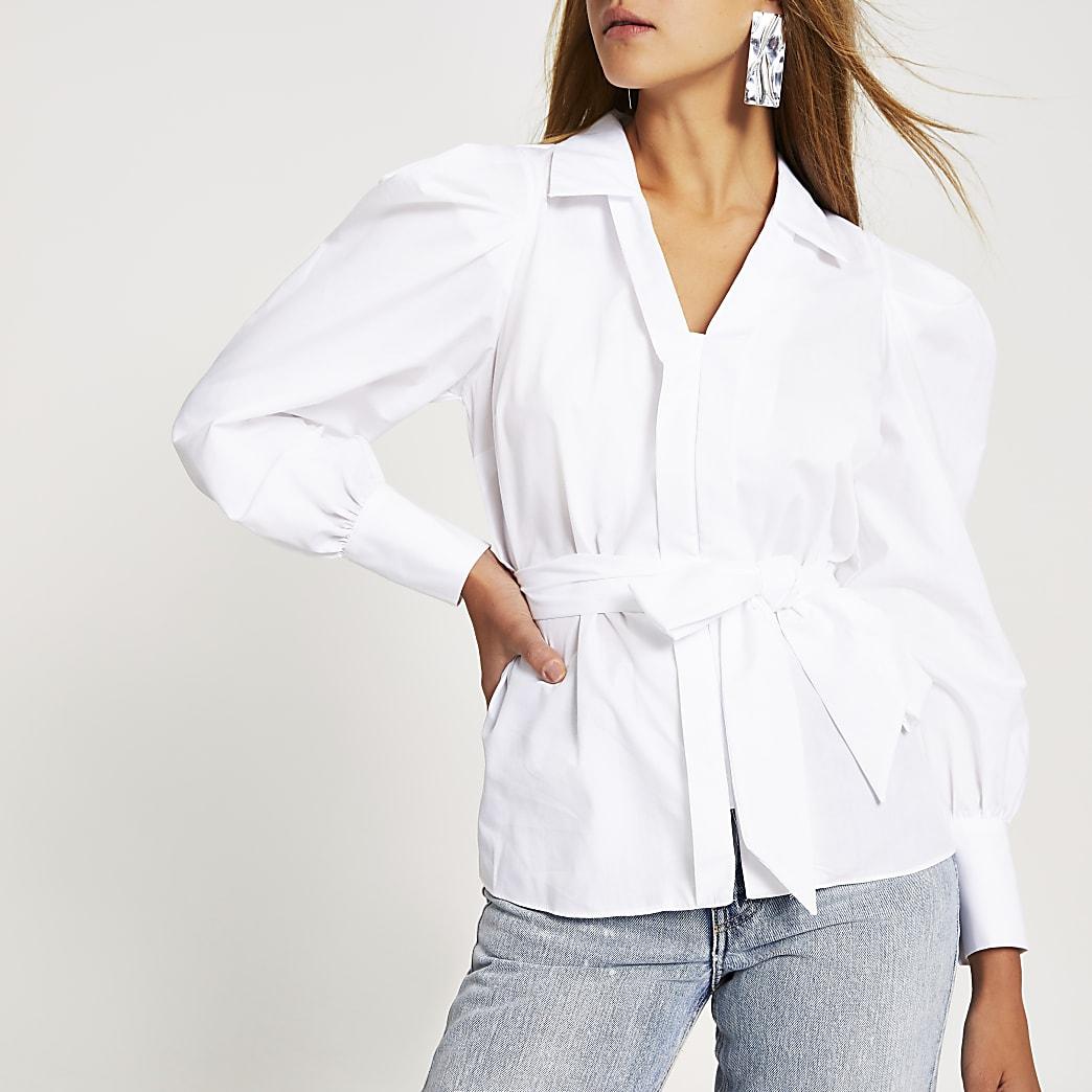 Witte top met lange pofmouwen en strikceintuur