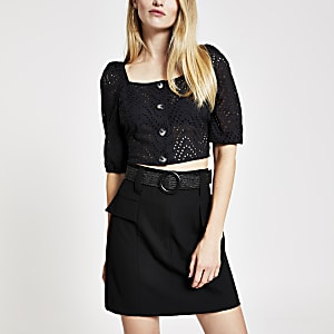 Black belted mini skirt