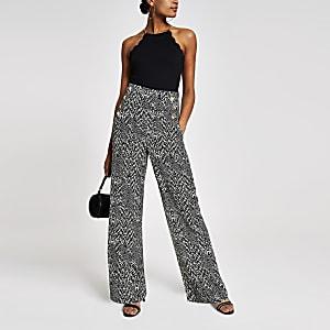 Zwarte broek met wijde pijpen, print en knopen