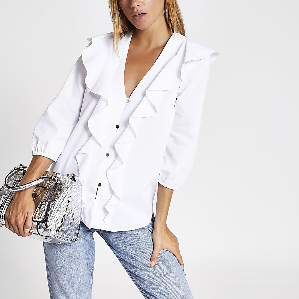 Witte blouse met ruches voor