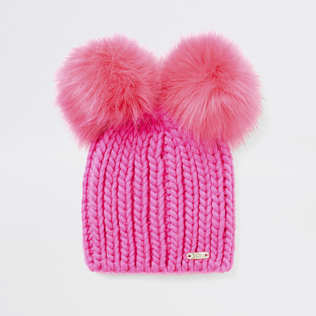 Bright pink faux fur pom pom knitted hat