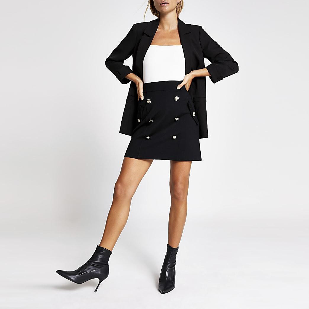 Black ponte button detail mini skirt