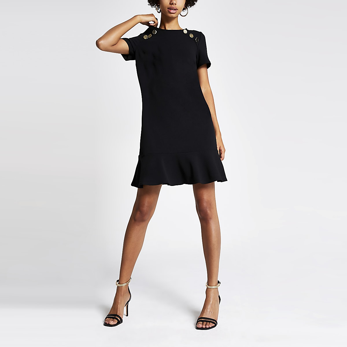 Black short sleeve peplum hem shift dress