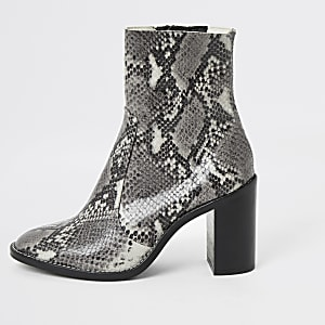 Grey snake print leather heel sock boots
