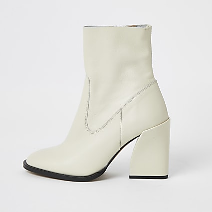 Ecru leather curved heel sock boots