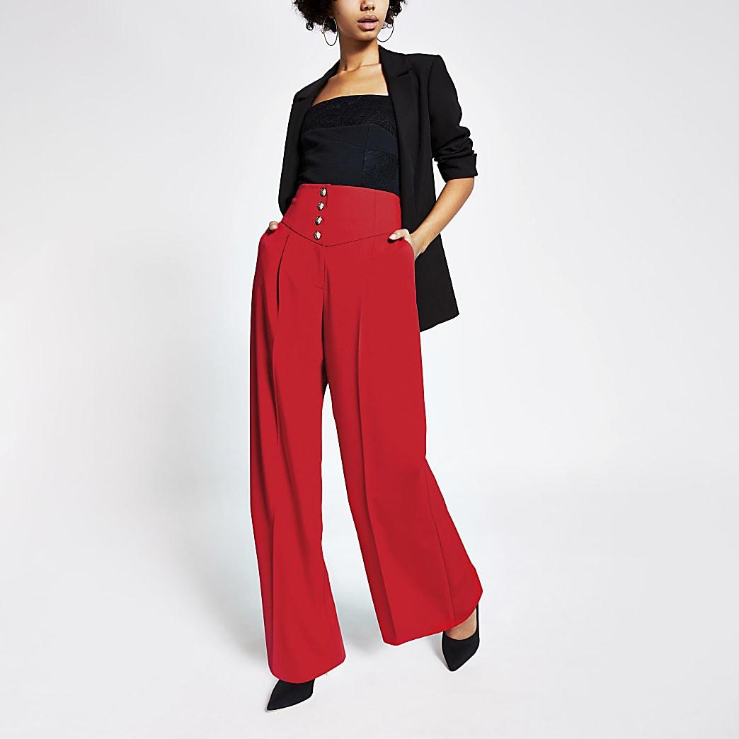 Rode broek met wijde pijpen en hoge korsettaille