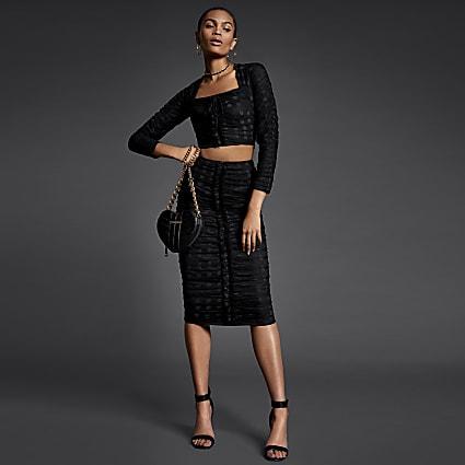 Black polka dot ruched bodycon midi skirt