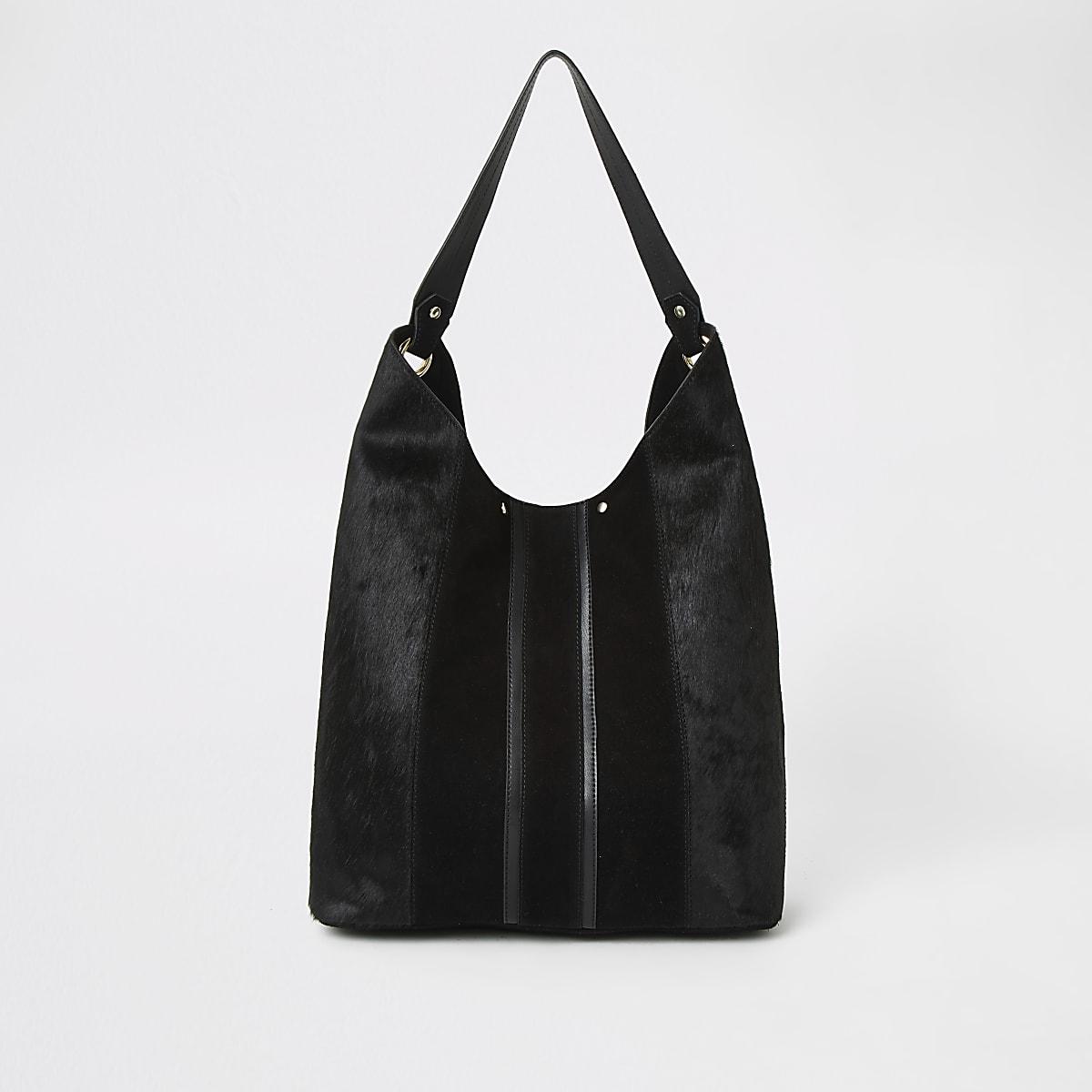 Zwarte tas met leren panelen