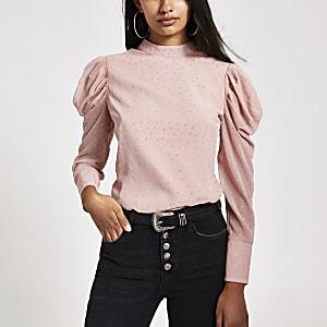 Roze top met lange pofmouwen en siersteentjes