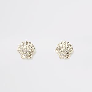 Goudkleurige oorbellen in schelpvorm met ingelegde steentjes