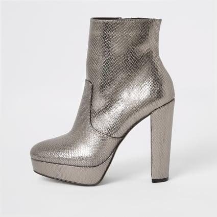 Silver embossed platform heeled boots