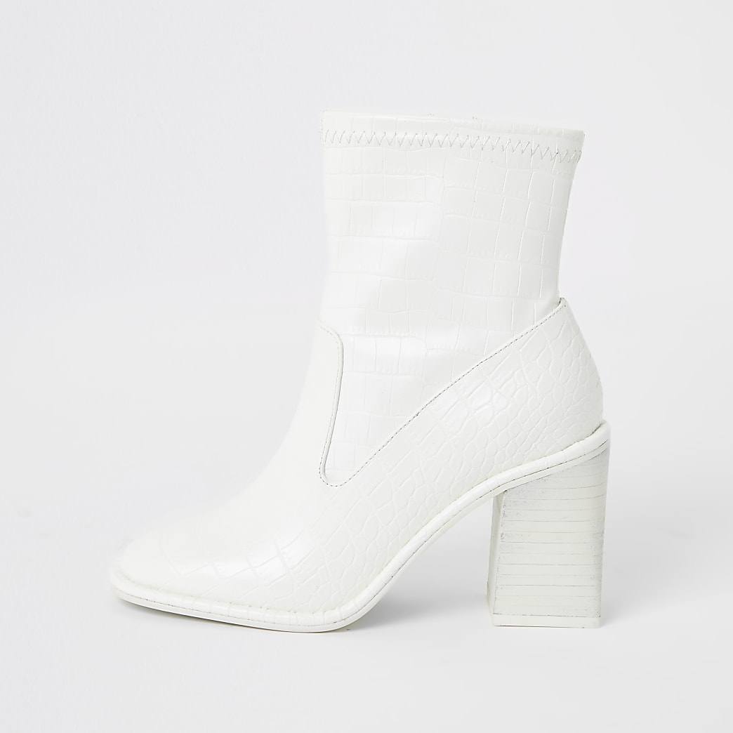 White croc embossed heeled ankle boots