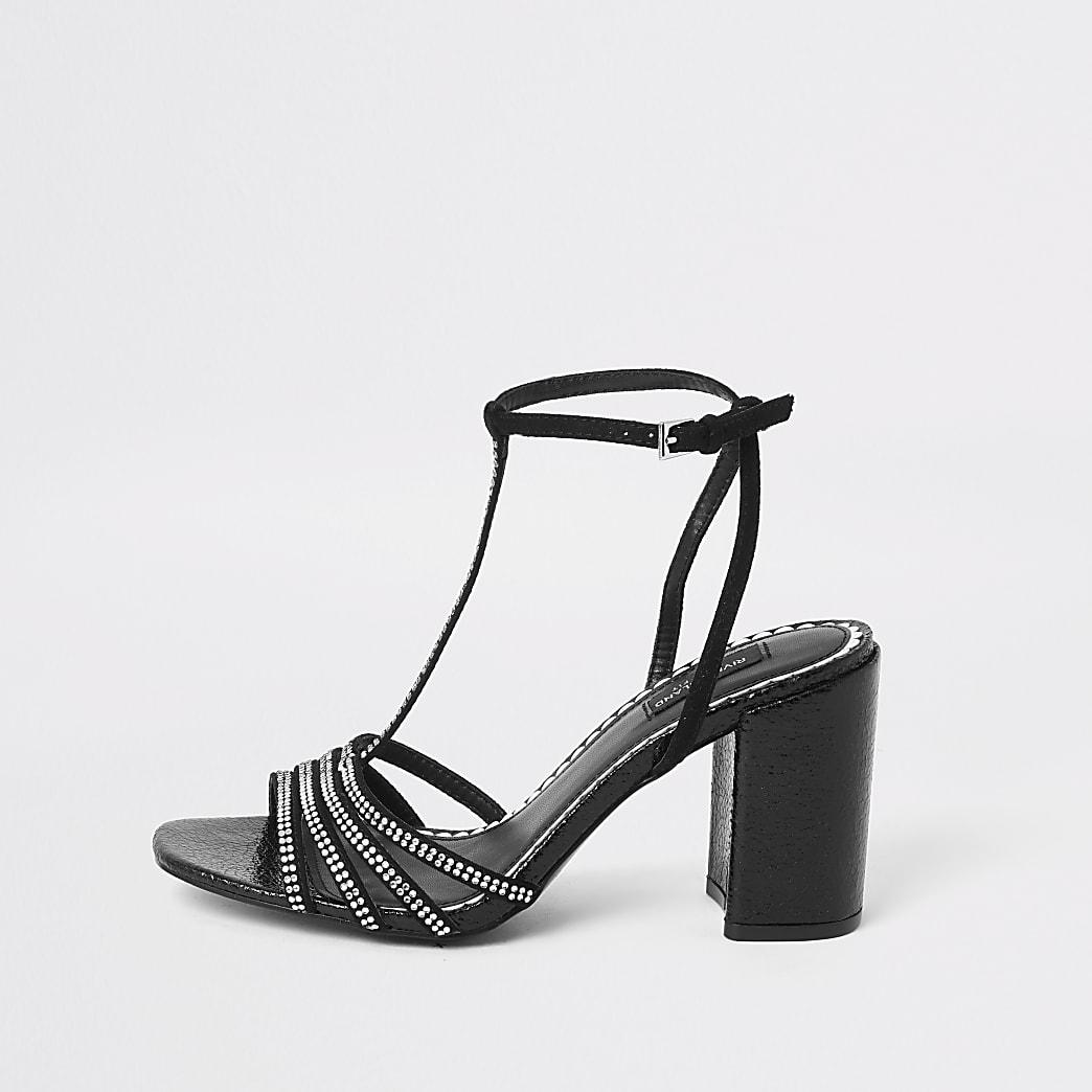 Schwarze, hochhakige Sandalen mit strassverziertem T-Riemen und weiter Passform