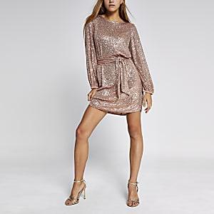 Roze lovertjes mini-jurk met ceintuur en pofmouwen
