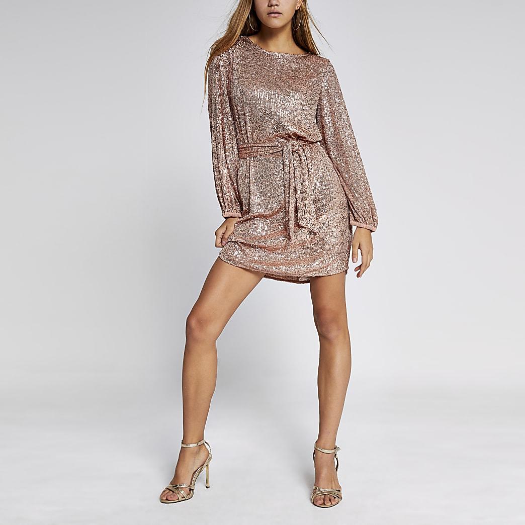 Roze  mini-jurk met lovertjes, ceintuur en pofmouwen