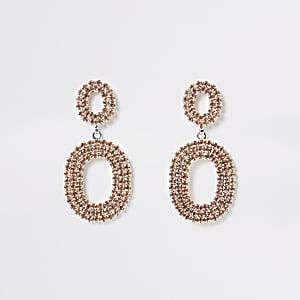 Pendants d'oreilles ovales aspect or rose à strass
