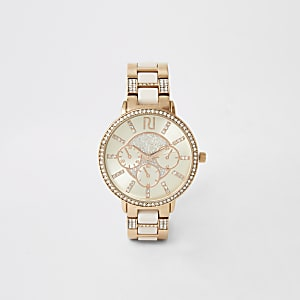 Montre or rose avec strass