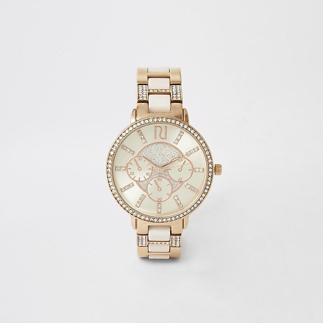 Roze horloge met roségoudkleurige siersteentjes