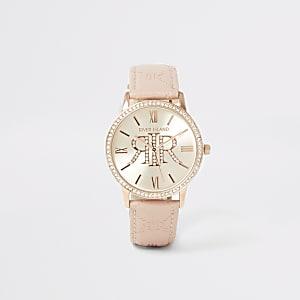 Armbanduhr in Rosa mit RI-Prägung und strassverzierter Einfassung