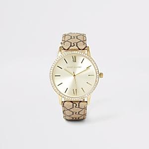 Goudkleurig horloge met bandje met siersteentjes en RI-monogram