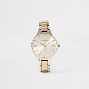 Roségouden horloge met RI-siersteentjes in reliëf