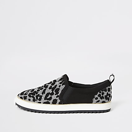 Black print slip on trainers