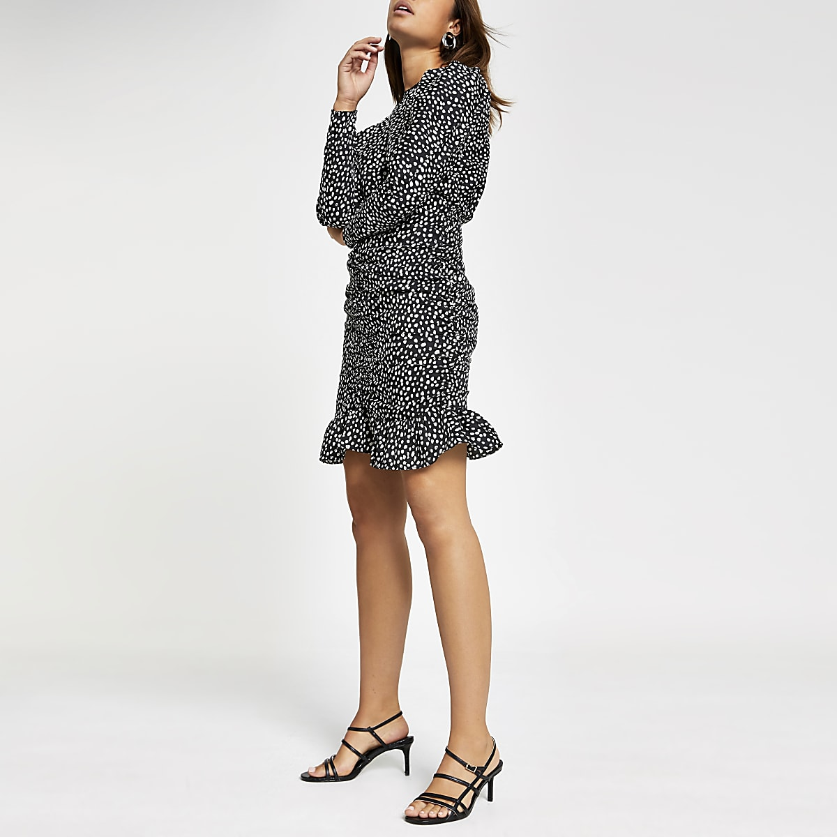 Black polka dot ruched mini dress