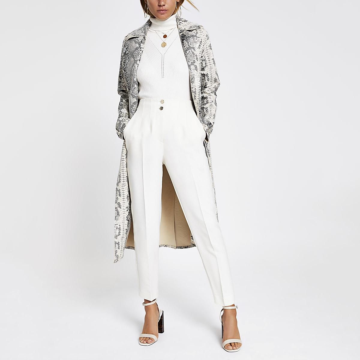 Crèmekleurige broek met hoge taille en smalle pijpen tot de enkel