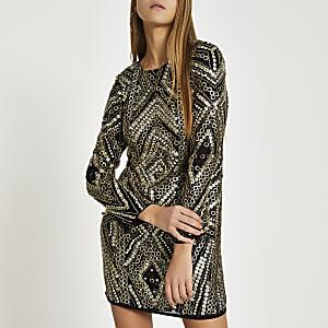 Zwarte mini-jurk met verfraaide lange mouwen