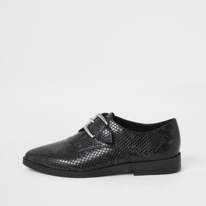 Black embossed monk strap buckle shoe