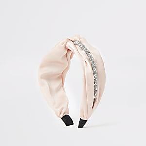Roze verfraaide gedraaide haarband