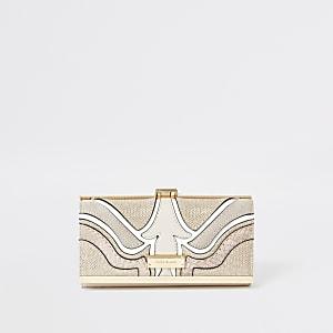Roze portemonnee met knipsluiting en glitters in uitgesneden wervelpatronen