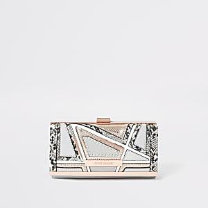 Grijze portemonnee met knipsluiting, slangenprint in reliëf en uitsneden