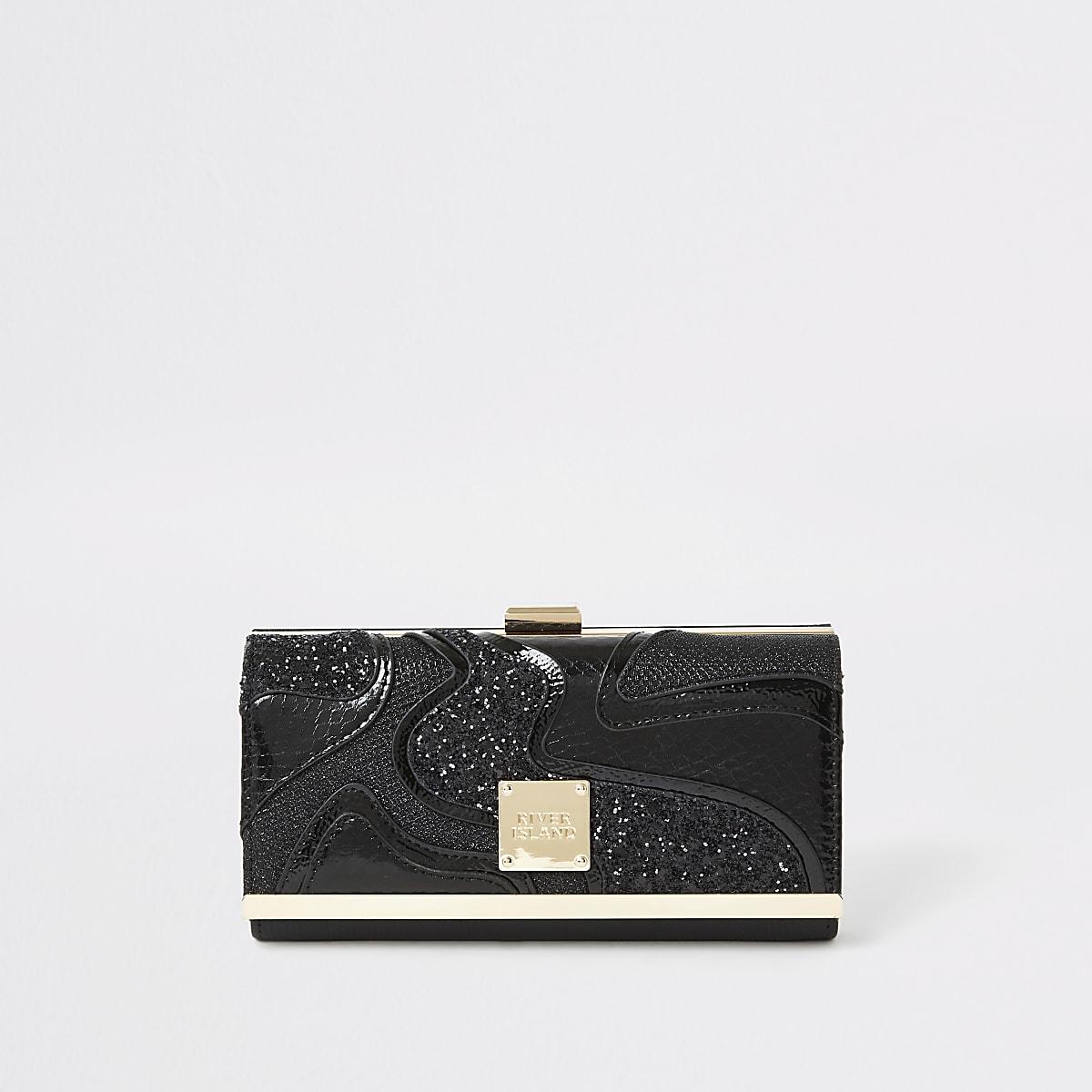 Zwarte portemonnee met knipsluiting en glitters in uitgesneden wervelpatronen