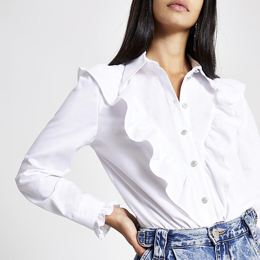 Wit overhemd met lange mouwen en ruches