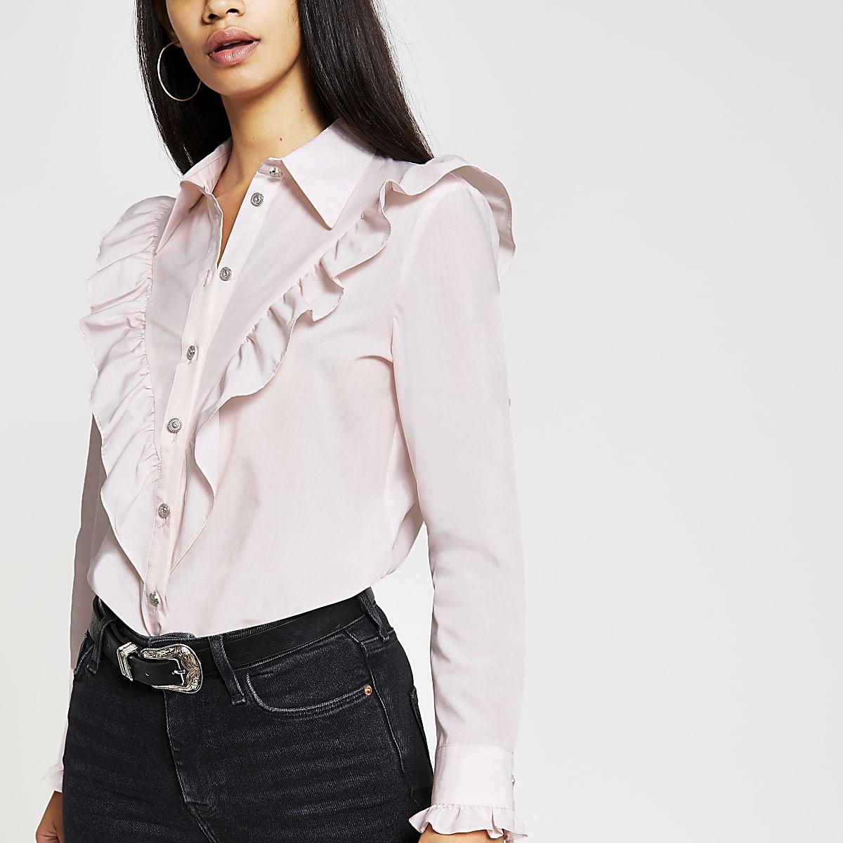 Chemise rose à plastron à volants et manches longues