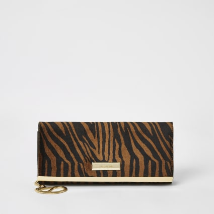 Brown tiger printed baguette clutch bag