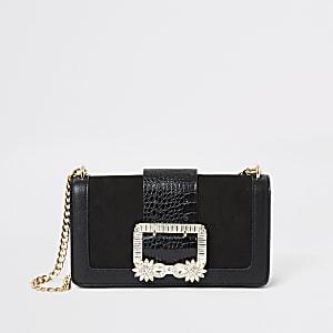 Schwarze Unterarmtasche mit geschmückter Schnalle