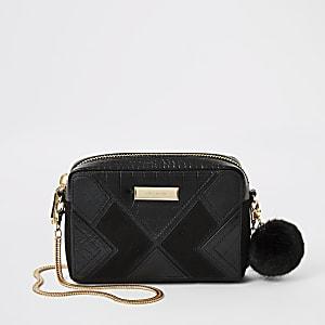 Zwarte crossbodytas met uitsnede
