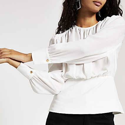 White long sleeve waisted top