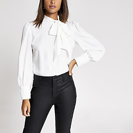White long sleeve tie neck top