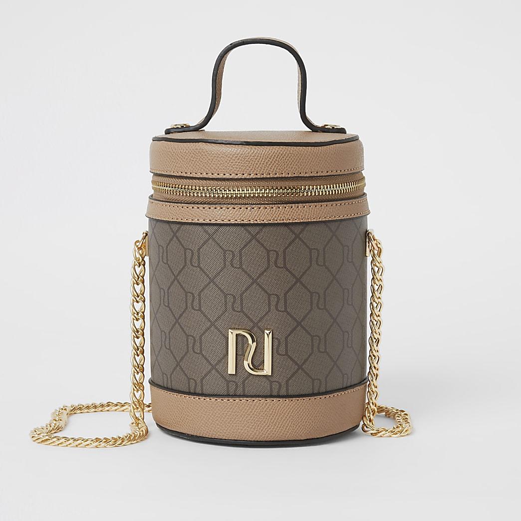Bruine cilindervormige tas met rits boven en RI-monogram