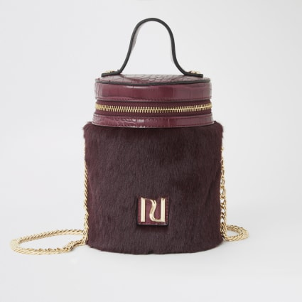 Dark red faux fur cylinder zip top bag