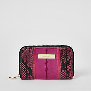 Roze portemonnee met rits rondom en slangenprint